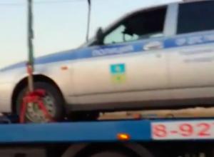 Волжан рассмешил эвакуатор, перевозивший машину ДПС через плотину ГЭС