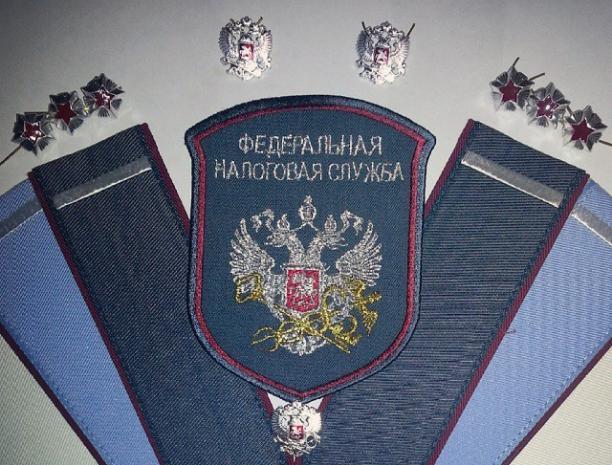 За взятку в двести пятьдесят тысяч рублей главного налогового инспектора взяли под стражу